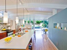 like the shelf under counter, tile wall, wall opening....Modern mid century kitchen