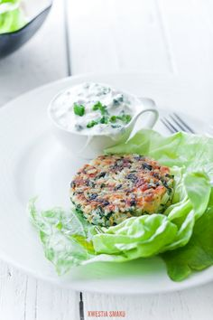 Burgers with salmon, spinach and rice   patties no batter light. Served on lettuce with lemon yogurt with chives.