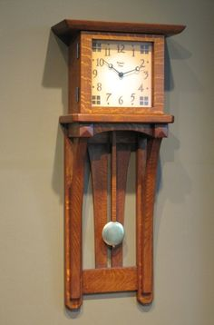 Present Time handmade clock - Trestle Arch Wall Clock 31″ Medium Finish. We love our Present Time clock (it is similar to this one)