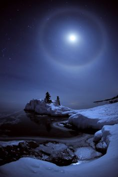 The rugged shore of Lake Superior can take on a look from another world in winter. This scene south of Grand Portage was illuminated by a full moon dog at  -28 degrees