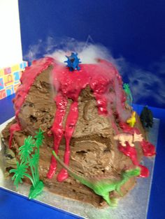 Volcano cake for a dinosaur party. Eruption using dry ice. #party #kids #science #cake #fizzics
