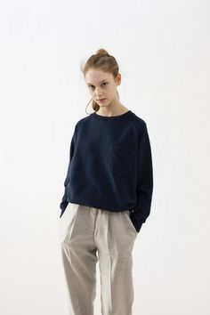 ponytail, navy sweater & grey pants with pleats #style #fashion #workwear…