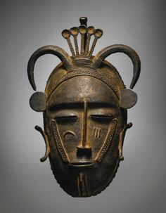 Sotheby's Diula or Senufo Brass Mask, Côte d'Ivoire 25,000 — 35,000