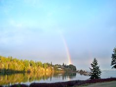 Spring rainbow over Ajax Cafe on Hadlock Bay, WA
