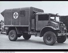 AUSTRALIA. TRUCKS, AMBULANCE, INDIAN ARMY TYPE, (AUSTRALIAN). THREE-QUARTER FRONT VIEW, RIGHT SIDE.