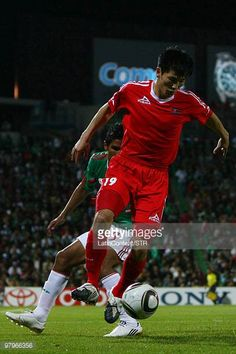 Mexico's Juan Carlos Valenzuela vies for the ball with An Chol Hyok of North Korea during an international friendly match between Mexico and North...