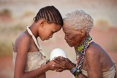 Africa: San girl and old woman, Namibia