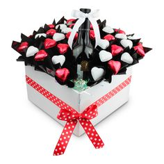 Hearts and Stars  Hearts and Stars is a stunning arrangement of 40 delicious assorted solid Cadbury chocolate Hearts & Stars and a of bottle of booze of your choice.   Hearts and Stars comes with a COMPLIMENTARY gift message card.   Next day delivery available to most Sydney Metro and Central Coast areas.