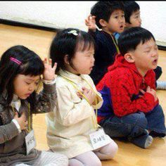 Children praying in Korea. <3 this picture is too precious for me to put into words. I love these children with all my heart.