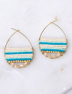 Teardrop shaped gold plated brass hoop earrings with Mother of Pearl, brass beads and high-quality Japanese Delica® seed beads. A perfect blend of cheerful, elegant and relaxed, yet refined design. -
