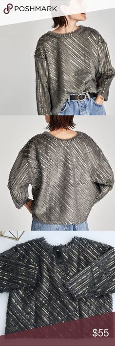 Zara Gray and Metallic Sweater Zara Fuzzy Gray and Gold Metallic Sweater. Features Round neckline. The color in my photos came out darker but it's really gray.  Material: 100% Polyester Zara Sweaters