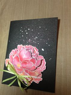 IO rose embossed & watercolored on black w Perfect pearls spritzed and drops of SU platinum shimmer paint.
