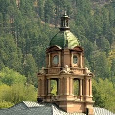Deadwood Dome Above the Rooftops Photograph - Deadwood is a city in South Dakota, United States, and the county seat of Lawrence County. It is named for the dead trees found in its gulch. The population was 1,270 according to the 2010 census. The city includes the Deadwood Historic District, a National Historic Landmark District, whose borders may be the city limits.
