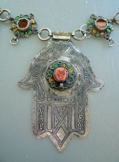Detail from a Moroccan hamsa necklace from the Tiznit region in South Morocco. Silver, enamel, and coral Fatima Hand, Tribal Jewelry, Bohemian Jewelry, Silver Jewelry, Hamsa Jewelry, Silver Ring, Collar Hippie, Art Beauté, Moroccan Jewelry