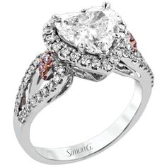 Heart Shaped Halo Diamond Engagement Ring in 18K White Gold with Split Shank by Simon G. Available at BenGarelick.com starting at $3740. https://www.bengarelick.com/products/simon-g-18k-white-gold-split-shank-heart-shaped-halo-diamond-engagement-ring