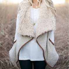 "Faux Fur Shearling Vest ✨JUST IN✨   ▪️Best selling faux fur vest with faux leather trim. It's so soft and cozy, and it will go great with almost anything!  It's a fall must-have!   ▪️Color is beige.   ▪️78% acrylic, 18% wool, 4% Polyester; trim: 100% polyester   ▪️Medium: 24.5"" long, 20"" bust 