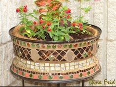 Who'd believe this ly homemade Mosaic Flower Planter is actually an old tire rim?  It's an easy DIY project that you'll .
