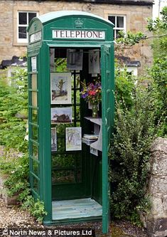 This rare green BT phone box in County Durham has been converted into a tiny art gallery. John Hay said he was hoping to bring a bit of British eccentricity to the village in Teesdale by filling the box w/ paintings.The phone box was originally put up after villagers complained the postmistress was listening into calls on the telephone located inside the post office. Sir Frederick Milbank, a local landowner, agreed to allow the box on his land on the condition that it be painted green.