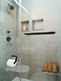 """""""I got rid of the bathtub because I like the idea of a big shower,"""" Pozner explains. But to achieve a comparable effect, he installed a teak bench from Waterworks on the rear shower wall. """"One of the things I like about a bath is that you can soak. Laundry In Bathroom, Bathroom Faucets, Small Bathroom, Bathroom Ideas, Bath Ideas, Rental Bathroom, Downstairs Bathroom, Bathroom Remodeling, Bathroom Inspiration"""