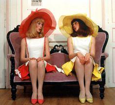 Catherine Deneuve and Francoise Dorleac wearing hats by Jean Barthet in 'Les Demoiselles de Rochefort', 1967.