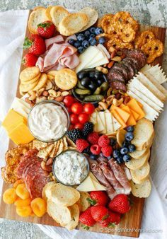 Learn how to make a Charcuterie board for a simple no-fuss party snack! A meat and cheese board with simple everyday ingredients is an easy appetizer! #appetizershealthy