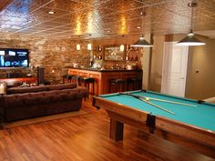 Featuring a pool table, wet bar, and a prime TV area, this man cave is well-equipped for game days