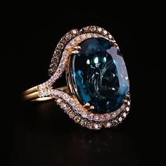 Le Vian Deep Sea Blue Topaz™️ Ring in Strawberry Gold®️️ with Vanilla Diamonds®️️ and Chocolate Diamonds®️️.