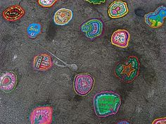 Artist Ben Wilson beautifies sidewalks as he paints original works on gum-splats.