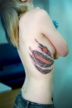 So Im thinking after I get skinny I want a tattoo kinda like this. But under the torn skin would be a soccer ball....