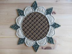 Quilted Table Mat Trivet Candle Mat Quilted Table Topper Sunflower Rustic Decor Farmhouse Decor Primitives Country Kitchen Housewares. $16.50, via Etsy.
