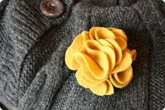 This is a better tutorial for those felt flowers.