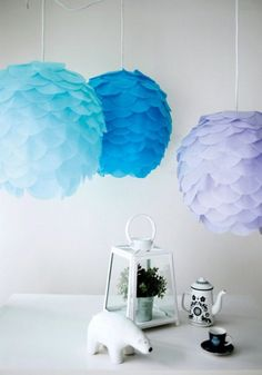 Here's our take on the Ph Artichoke lamp. Start with a round Regolit paper lampshade from Ikea (or a balloon, if you're planning to do this as temporary decor). Cut out about 80 discs with five-inch diameters from coloured crepe paper. Then, starting from