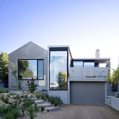 """Concrete House 2 by Auhaus Architecture Interiors [@auhaus] in Bellarine Peninsula. Photography via Auhaus Architecture Interiors. From the architects   """"The fine lined insitu concrete addition both simplified and exaggerates the geometry of the original house elongating and grounding the building and creating a strong connection to landscape at the front of the site."""" www.auhaus-arch.com for more. Would you build your house out of concrete? #concretehouse2 #aushausarchitecture…"""