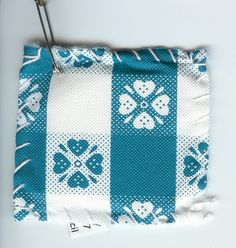 Sit Upon: 2 squares of vinyl tablecloth, yarn, good needle, paper towel (for stuffing), safety pin