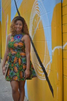 Lexi With TheCurls A gold clutch and soft blonde waves are the perfect accents to Lexi's Suakoko Betty ankara print dress.