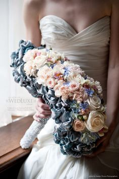 A work-of-art statement bouquet is achieved by adding hand-knotted satin ribbons to a glorious collection of blooms. Floral Design by Evan Orion of Flowerz, flower-z.com.
