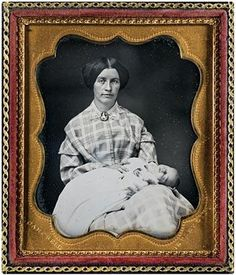 Postmortem photograph of an infant draped over mother's lap. (daguerreotype 1/6 Plate, Circa 1854)