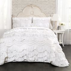 Bask in the luxurious comfort and superb craftsmanship of this frilly and fun quilt set. The perfect touch of dainty delight for any bedroom, this set comes with a ruffled, poofy quilt and matching sh