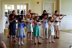 Darlington Arts Center - Photo Caption: Violinists perform for Arts Salute to Spring 2011 guests under the direction of Janka Perniss.