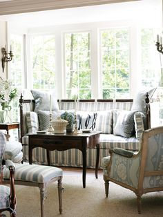 The latest incarnation of Carithers' own living room features an elegant blue-and-white color scheme. PHOTOGRAPHY BY EMILY FOLLOWILL