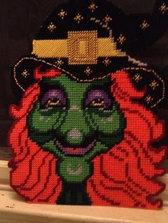 Plastic canvas witch I made around 15 years ago. To this day it's one if my favorite holiday decorations.