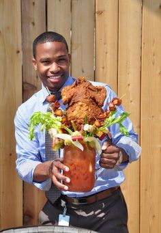 """WTF Chicken Fried Bloody Beast. It contains """"cheese, sausage, pickles, olives, onions, mushrooms, asparagus, scallions, shrimp, lemon, Brussels sprouts, tomatoes, celery,"""" and a whole fried chicken."""