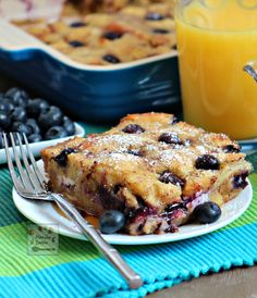 Juicy berries, crunchy walnuts plus yummy cream cheese and warmed up maple syrup make this a fantastic breakfast or brunch dish - Overnight Blueberry French Toast Casserole | manilaspoon.com
