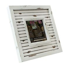 <div>Display a cherished photograph or artwork in this casual tabletop frame. The white distress...