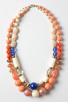 I like the use of orange with blue and cream and gold. Those colors balance the orange, making it less overwhelming. Fire & Firmament Beaded Necklace - Anthropologie.com