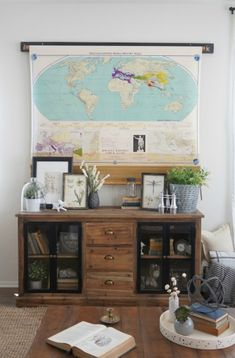 Love this idea - a vintage pull down map covers the TV eclecticallyvintage.com