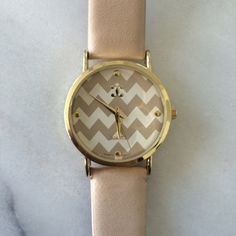 Charming Charlie's Gold Watch Ivory Chevron Great condition! I never wear this one anymore because I got a Michael Kors Watch for Christmas. Charming Charlie Accessories Watches