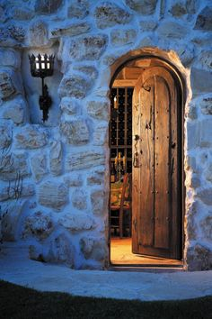 Wine Cellar Entrance  Crafted with an antique Mexican door, this custom exterior door exudes old world elegance. It features the antique clavos of the original door, and a cast bronze deadbolt and iron pera pull. 7709C Jensen Photo by Eric Swanson