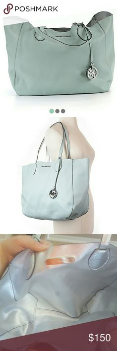 Sky blue Michael Kors tote Practically new used once! Good conditon. Sitting in my closet for a  month looking for new home! Michael Kors Bags Totes