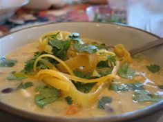 Creamy Chicken Tortilla Soup - I doubled the recipe and made the following changes: store bought rotisserie chicken deboned - used ALL the meat for the soup. Used home made stock - not canned.  3 cloves minced garlic & kosher salt to taste.  Doubled the amount of cumin  powder.  Cut the milk in half & added heavy cream to make up for it.  Served with toppings of chopped cilantro, grated sharp cheddar cheese, chopped green onion, & wedges of lime.   Very hearty and flavorful.